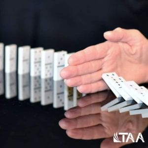 Stopping dominoes from falling