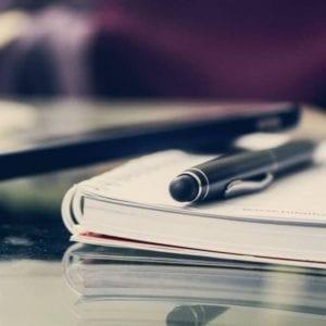 pen sitting on writing journal